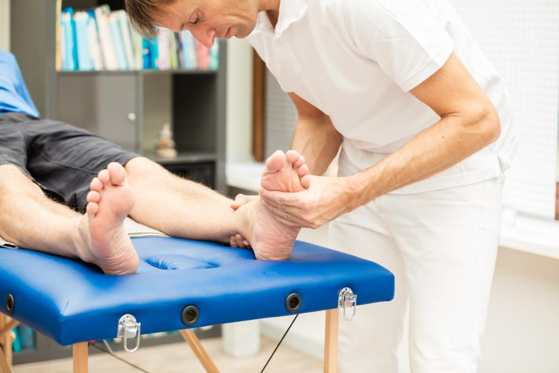 podiatrist-inspecting-patient-s-feet