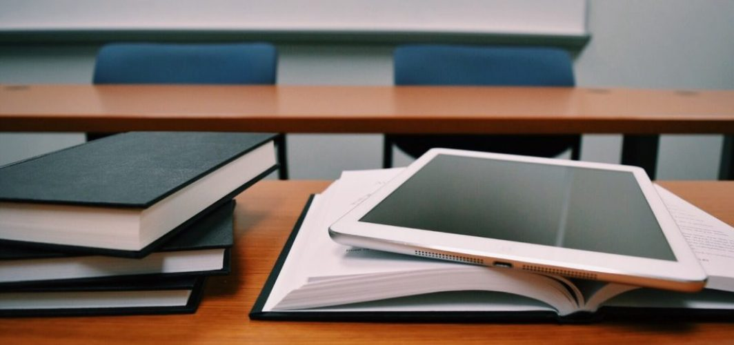 books and tablet on the table